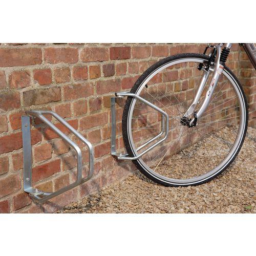 Adjustable wall mounted cycle holder